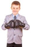 有拳击手套的英俊的小男孩,被隔绝 免版税图库摄影