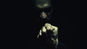 有拳头的邪恶的人 免版税图库摄影