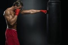 有拳击袋子的可爱的人 图库摄影