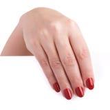 有拿着一个空白广告牌的红色长的钉子的美好的女性现有量 免版税库存图片