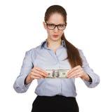 有拿着一百元钞票的蔑视的妇女 库存照片