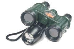 有指南针的双筒望远镜 库存图片