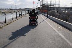 有挡风玻璃的电动轮椅 免版税库存图片