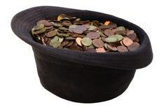 有捐赠的金钱的帽子 免版税库存图片