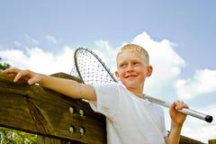 有捕鱼网的男孩 免版税库存照片