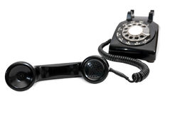 有接收器的经典黑轮循拨号电话在焦点 免版税图库摄影