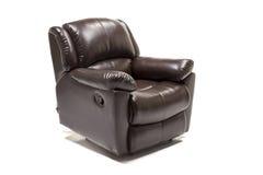 有控制旋钮的黑皮革可躺式椅反对白色背景 免版税库存照片