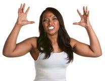 有握紧的牙的妇女 免版税图库摄影