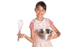 有搅蛋器和钢碗的IV女孩 免版税库存照片