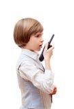 有携带无线电话的男孩 免版税库存图片