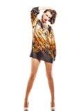 有摆在照相机的长的腿的美丽的妇女 图库摄影