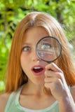 有放大镜的子项 免版税库存照片