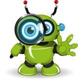 有放大镜的机器人 免版税库存图片