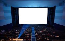 有放映机光的戏院观众席。 库存照片