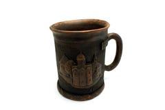 有教会的图象的杯子 免版税库存照片