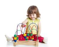 有教育玩具的女婴 库存照片