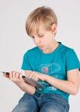 有数字化器的男孩 免版税库存照片