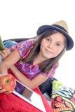 有数字式片剂和果子的女小学生 库存照片