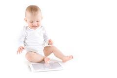 有数字式片剂的婴孩 库存图片
