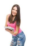 有数字式片剂的愉快的学生女孩 免版税库存照片
