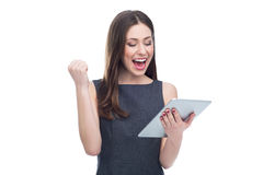 有数字式片剂的激动的妇女 免版税库存照片