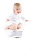 有数字式片剂的婴孩 图库摄影
