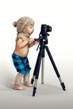有数字照相机的男孩 免版税图库摄影