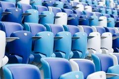 有数字的多彩多姿的扶手椅子在橄榄球场 蓝色和白色颜色 免版税库存照片