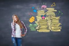 有文书工作堆的体贴的女孩 免版税库存图片