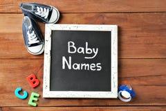 有文本婴孩名字的黑板 库存照片