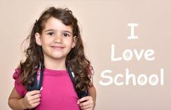 有文本的女孩我爱学校 库存照片