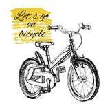 有文本的手拉的少年自行车 皇族释放例证
