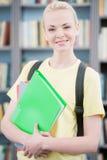 有文件夹的少年学生 库存图片