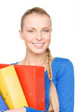 有文件夹的年轻可爱的女实业家 免版税库存图片
