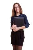 有文件夹的年轻学生在她的手上 库存照片