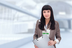 有文件文件夹的女实业家。 免版税库存图片
