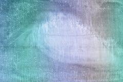 有斑点和污点的,板岩纹理老墙壁  与一个多彩多姿的梯度的被设色的照片 一异常 免版税库存照片
