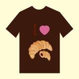 有新月形面包的图象的一件棕色T恤杉 免版税图库摄影