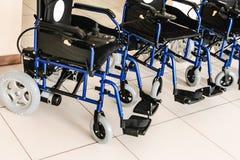 有新电的驱动的轮椅 库存照片