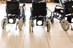 有新电的驱动的轮椅 免版税库存图片