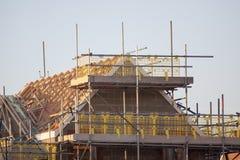 有新的家的建筑工地 免版税库存图片
