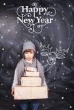 有新年礼物的小男孩 免版税库存照片