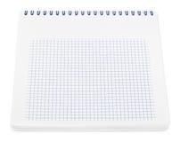 有方格纸板料的螺纹笔记本 免版税图库摄影