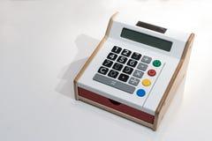 有旁边木头和红色抽屉的五颜六色的计算器 免版税库存照片