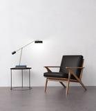 有旁边桌的典雅的皮革扶手椅子 免版税库存图片