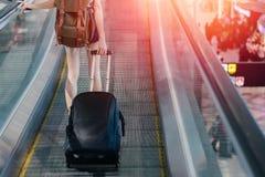 有旅行在机场的行李的中央部位妇女 免版税库存图片