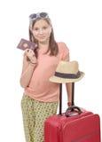 有旅行袋子的,护照微笑的女孩被隔绝在白色 免版税库存图片