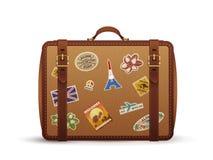 有旅行贴纸的老葡萄酒皮革手提箱,传染媒介例证 库存照片