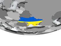 有旗子的乌克兰在地球 免版税库存照片