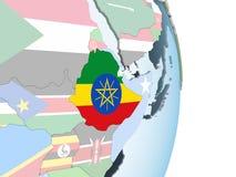 有旗子的埃塞俄比亚在地球 库存例证
